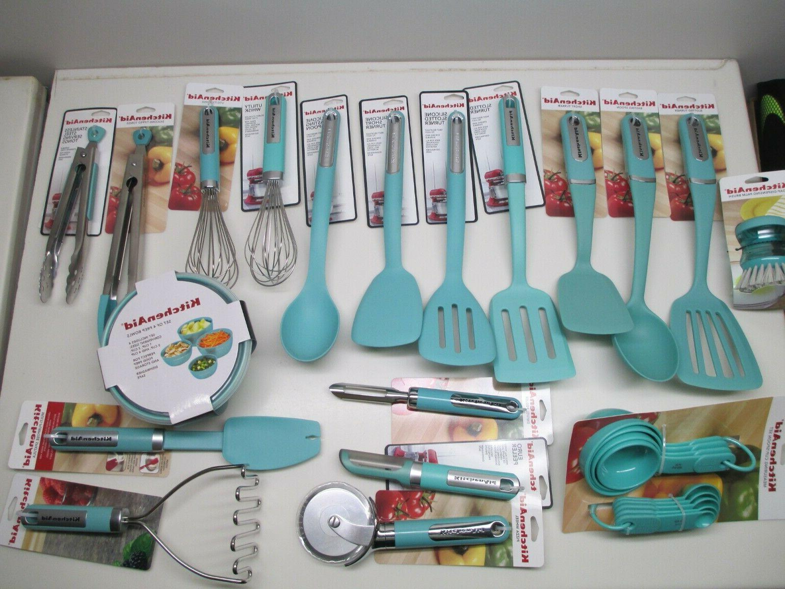 kitchen utensils and towels in aqua sky